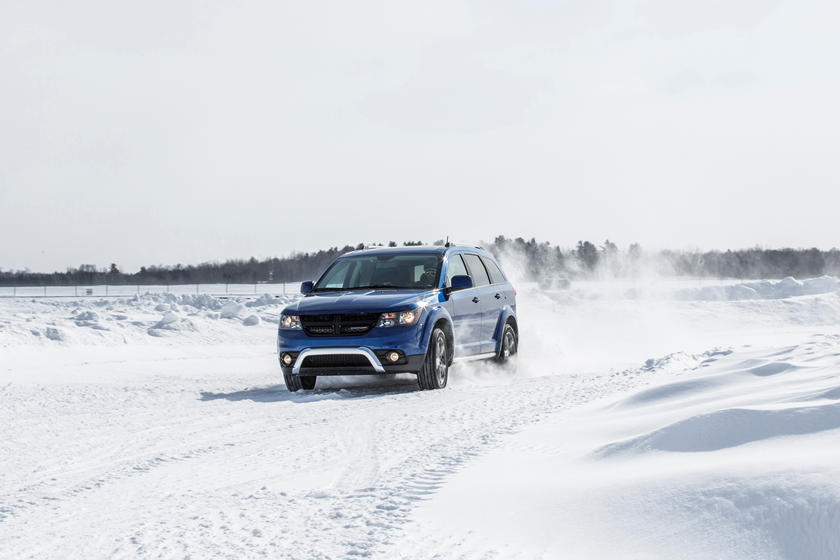 blue 2019 dodge journey in snow track