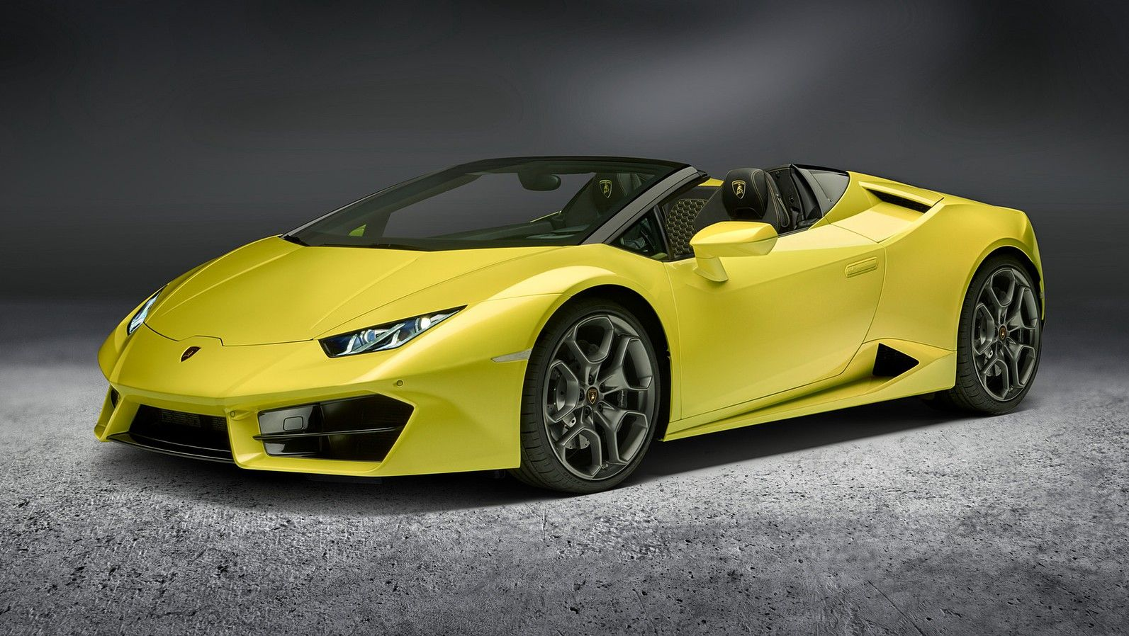 yellow 2020 lamborghini huracan front three quarters
