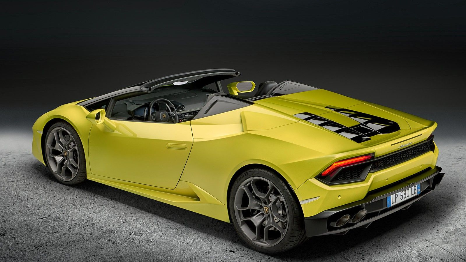 yellow 2020 lamborghini huracan rear three quarters