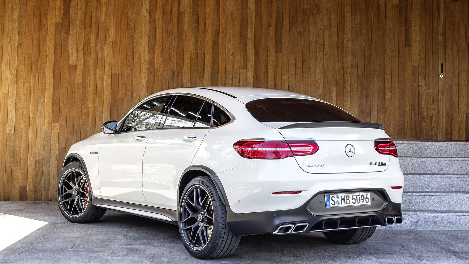 2020 Mercedes AMG GLC 63 Coupe SUV white rear three quarters