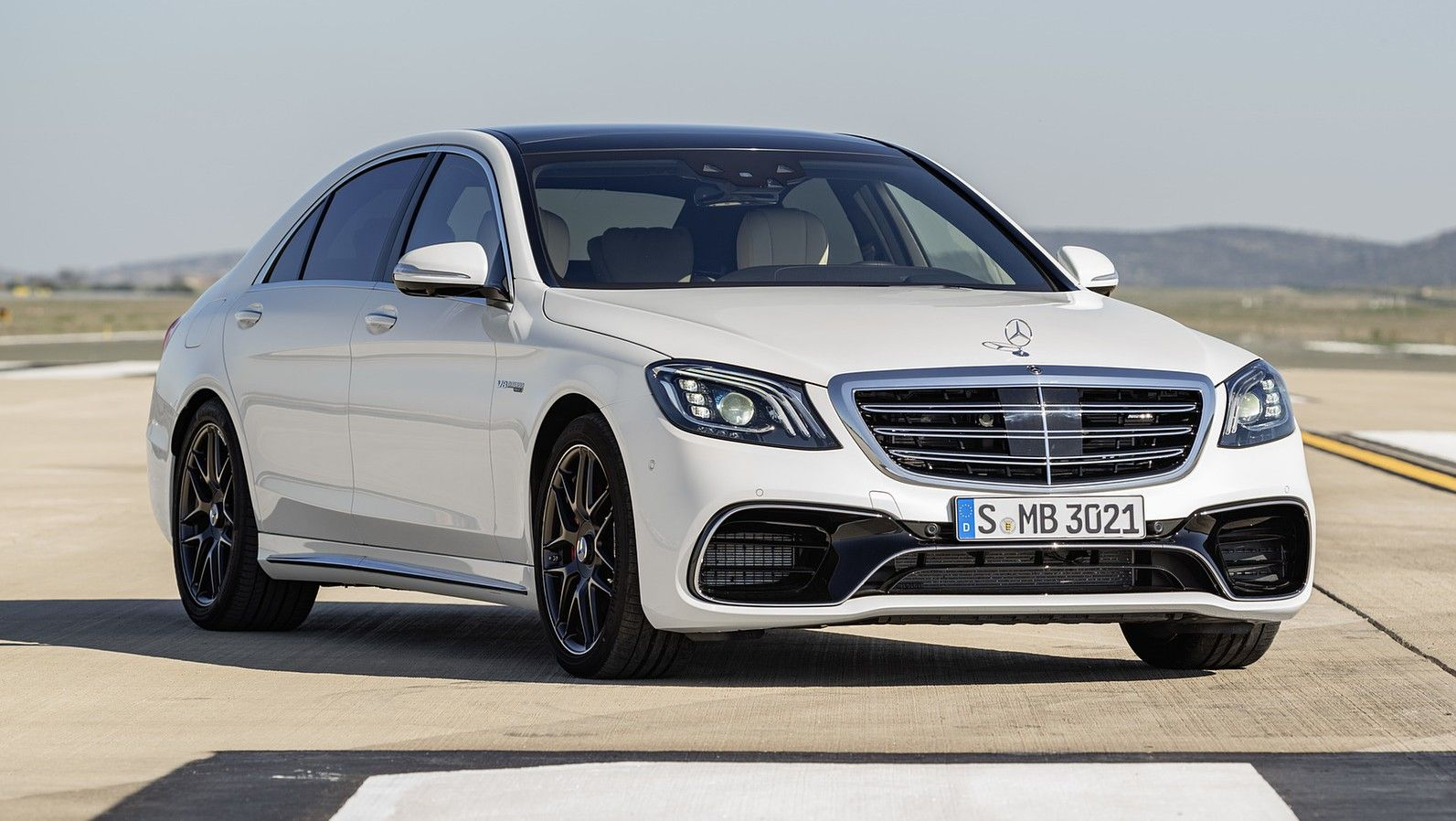 2019 mercedes amg s63 sedan white front three quarters