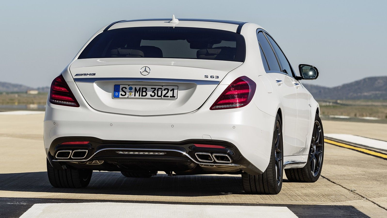 2019 mercedes amg s63 sedan white rear three quarters