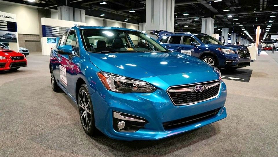 2019 Subaru Impreza Sedan front three quarters blue